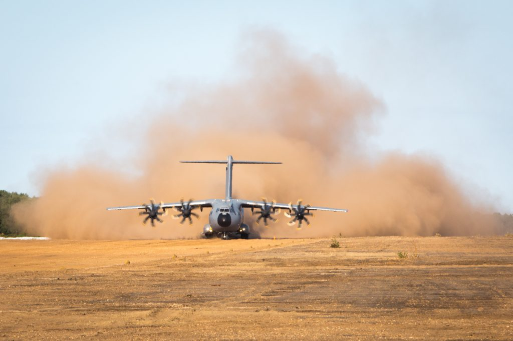 The Airbus A400M and TP400-D6 engines operating in a sandy environment.